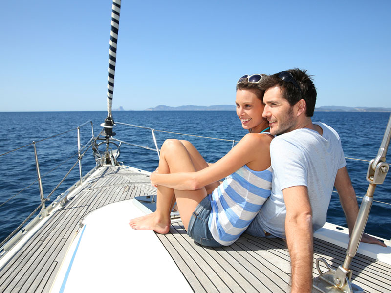 Couple sitting together on sailing yacht.