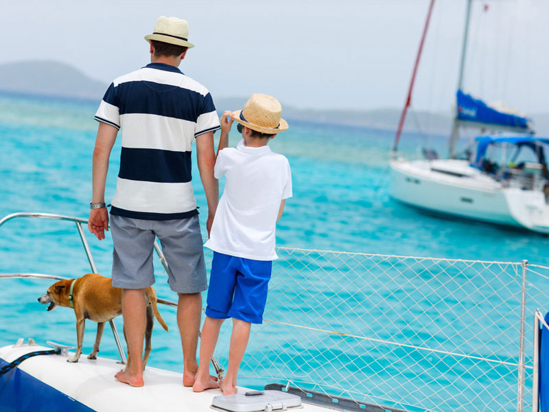 Father with son and dog at marina.