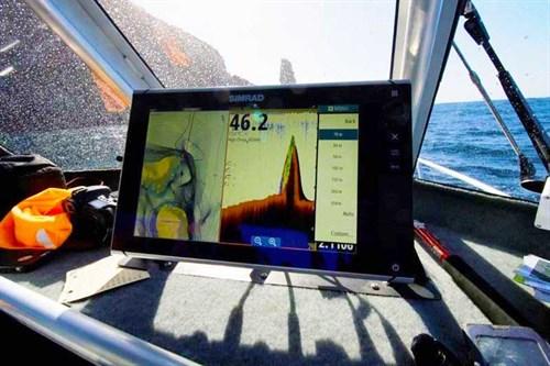 Simrad NSS12 showing uncharted pinnacle on ocean floor