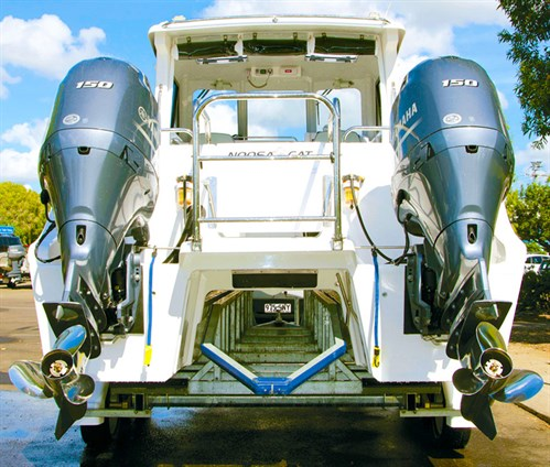 Twin Yamaha F150 outboard motors on Noosa Cat 2400