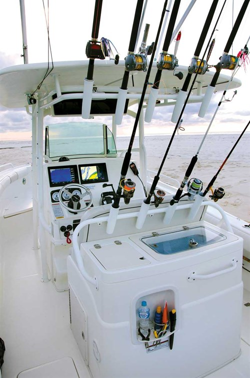 Rod holders and centre console on Mako 284 boat