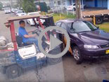 idiots moving car wirth forklift