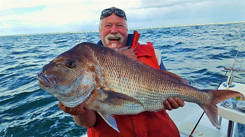 Bear With The Result Of A Rough Water Snapper Sojourn . This Snapper Weighed 9.5 Kg (21lb ) (2)