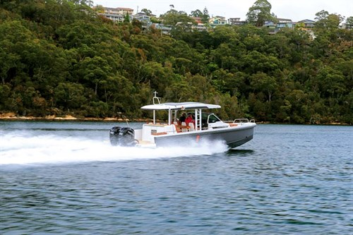 Axopar 37 boat with twin Mercury 350 Verado outboards on the water