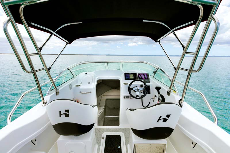 Helm and cabin of a Haines Hunter 565R boat