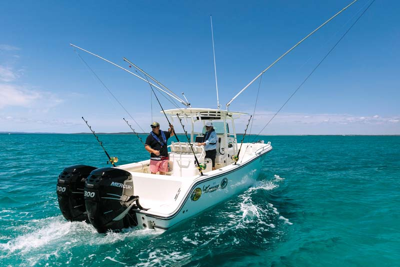 Mako 284 Centre Console on the water with twin outboard motors