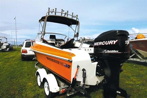 Orange Haines 17L on boat trailer