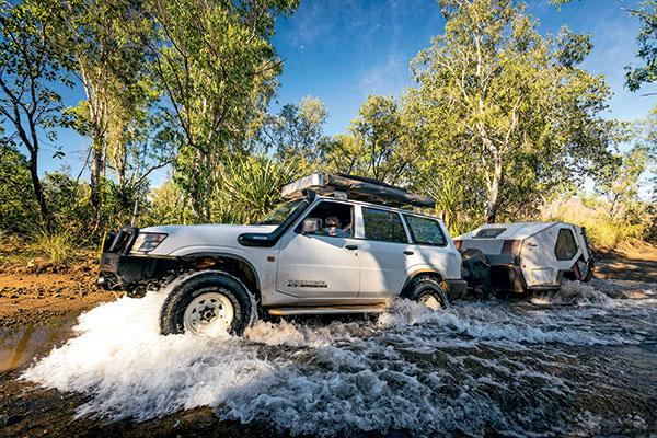 Towing -a -small -caravan -through -the -river