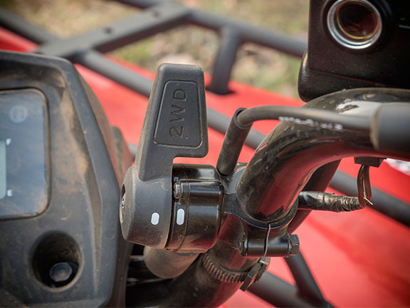 The 4WD actuator is a small lever located on the right hand side of the handlebar.