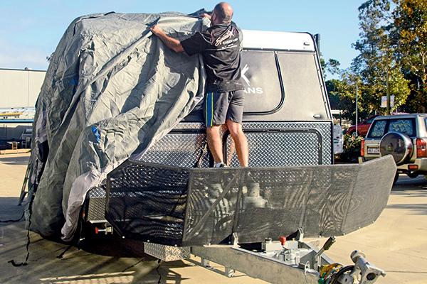 A-man -covering -a -caravan