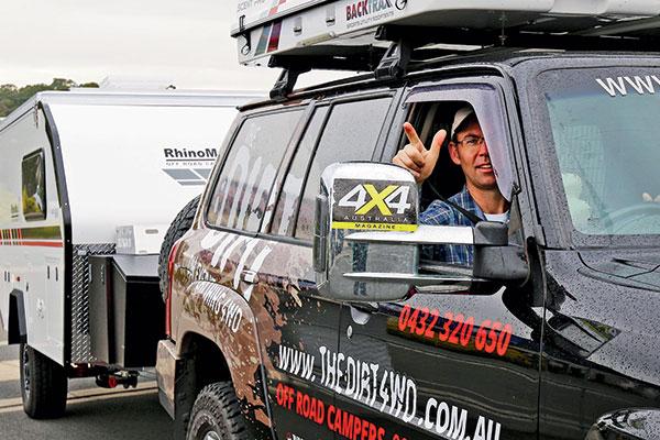 A-man -towing -a -caravan -and -non -verbally -communicating
