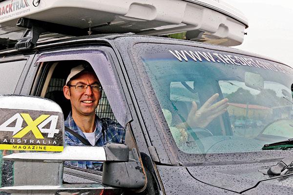 A-man -waving -in -a -car