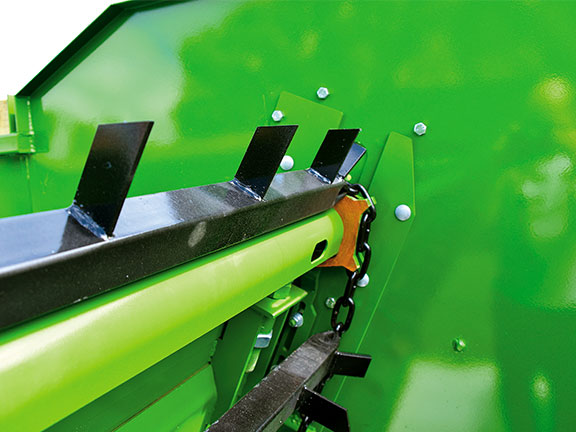 Photo of the covered drive shafts of the Hustler SF1250 Silage Wagon