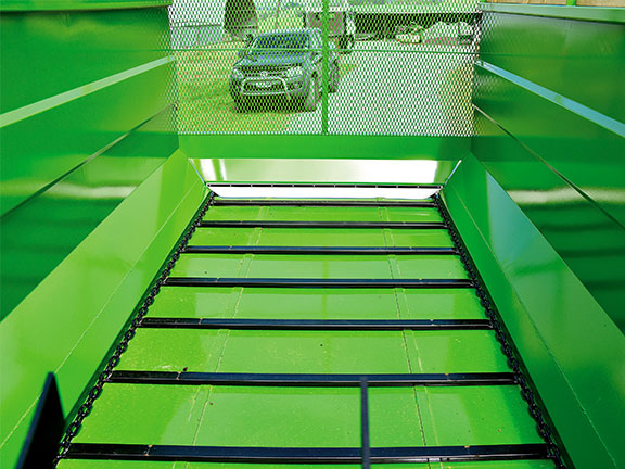 Photo of the clean bin design and tough steel floor of the Hustler SF1250 Silage Wagon