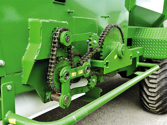 Photo of the heavy-duty drive system protected by bumper bars of the Hustler SF1250 Silage Wagon