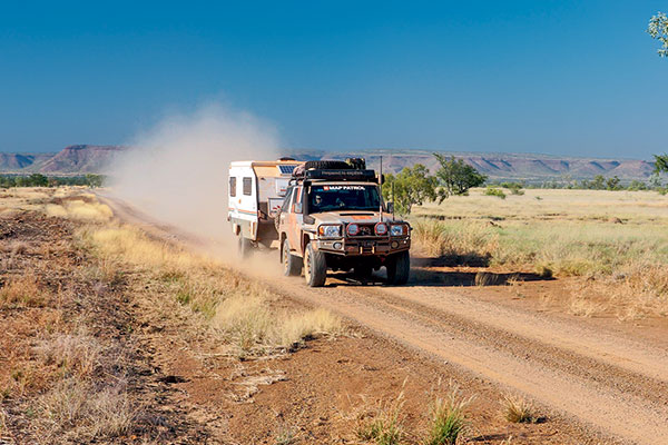 Towing -a -van -on -a -dusty -road