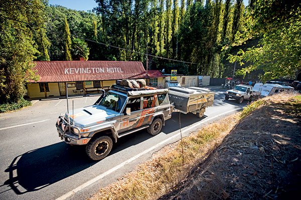 Hema -truck -towing -an -Avan -camper -and -Toyota -Land Cruiser -towing -New -Age -caravan -passing -by -the -Kevington -Hotel