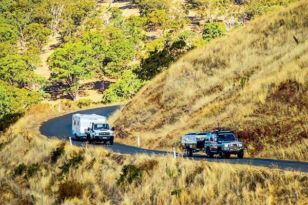 Hema -truck -towing -Avan -camper -and -Toyota -Land Cruiser -towing -New -Age -caravan -in -the -High -Country