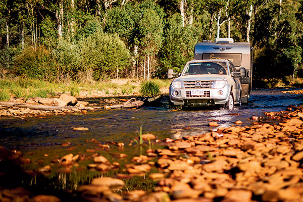 Mitsubishi -towing -JB-Scorpion -caravan -through -the -river -with -clearview -mirrors-