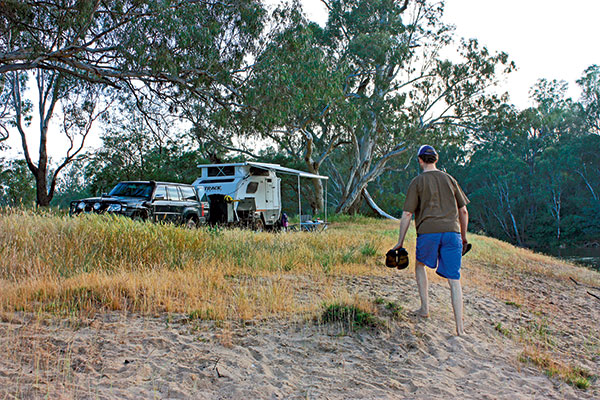 A-man -walking -up -the -hill -to -the -campsite