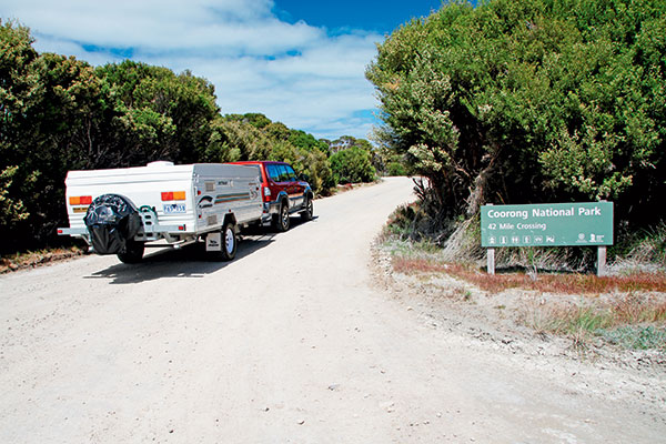 Driving -up -to -the -Coorong -National -Park -entrance -with -a -camper -trailer