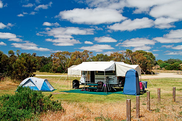 A-camper -trailer -and -a -tent -are -set -up -at -Coorong -National -Park