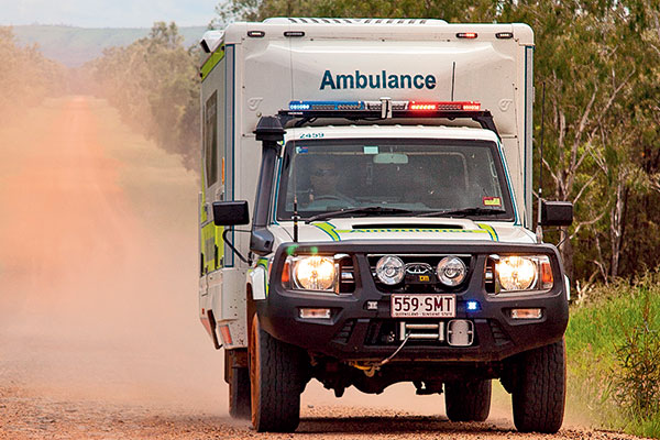 An Ambulance -driving -on -the -dirt -road