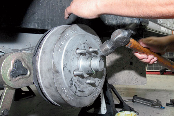 Tapping -dust -cap -into -position -on -the -wheel