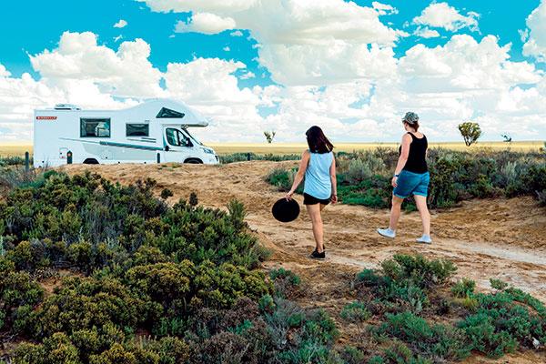 Two -women -walking -towards -Avida -Birdsville -at -Lake -Tyrrell -at -Sea -Lake -VIC