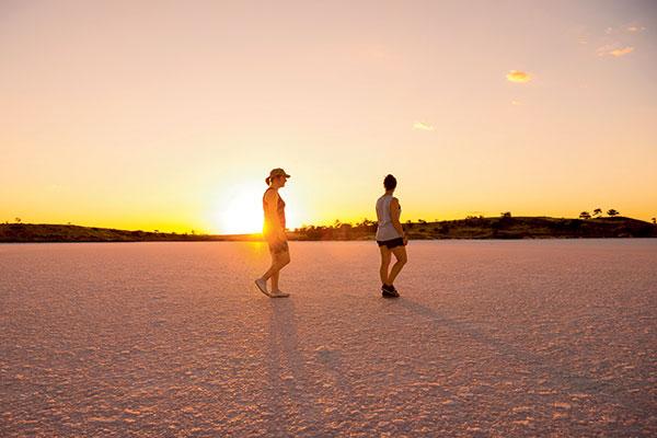 Two -women -walking -on -Lake -Crosbie -during -the -sunset