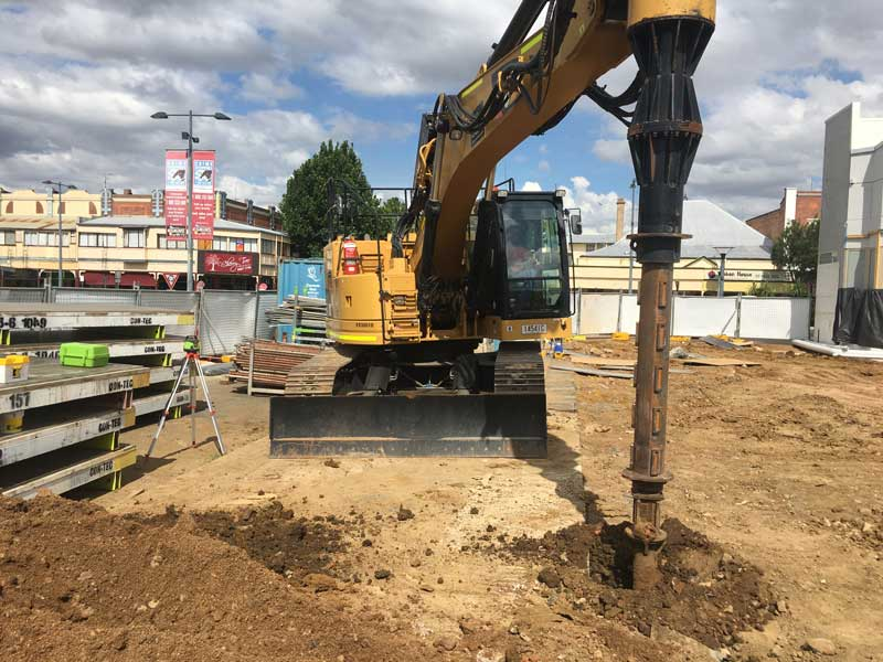 Cat 328D LCR excavator with piling drill