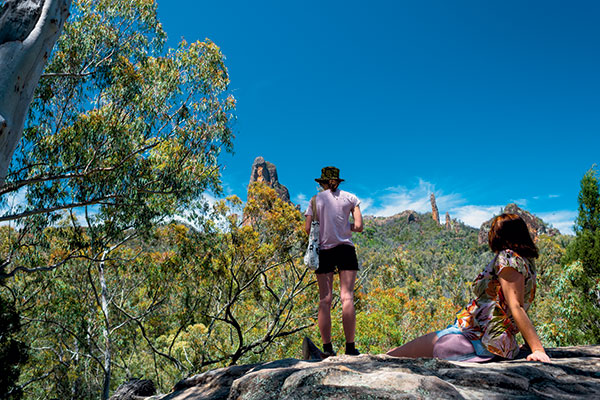 Two -women -looking -out -at -the -Warrumbungle -National -Park -NSW