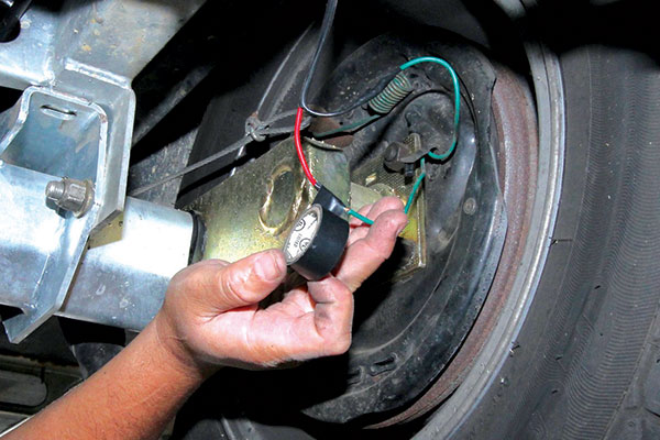 The -rejoined -caravan -brake -wires -are -covered -up -with -insulating -tape