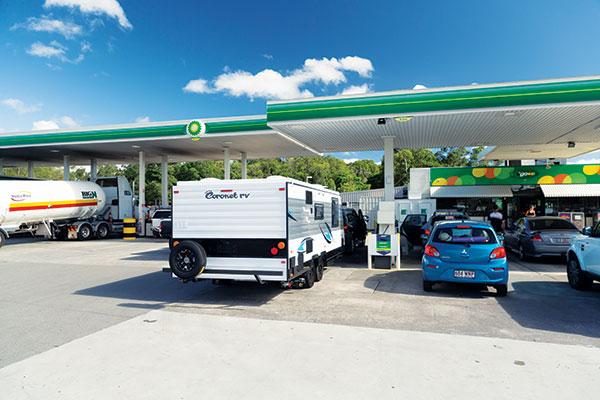 Coronet -rv -caravan -at -the -petrol -station
