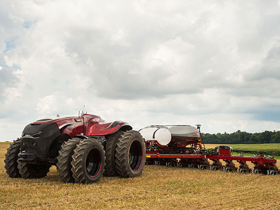 The Case IH ACV hooked up to a sprayer