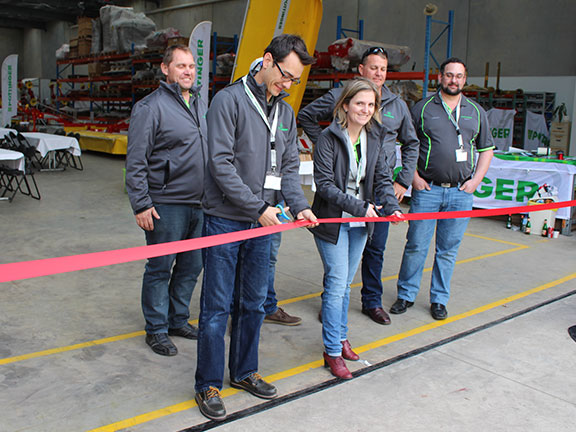 Poettinger GM Eva-Marie Heikenwaelder cuts the ribbon to signify the new facilities opening