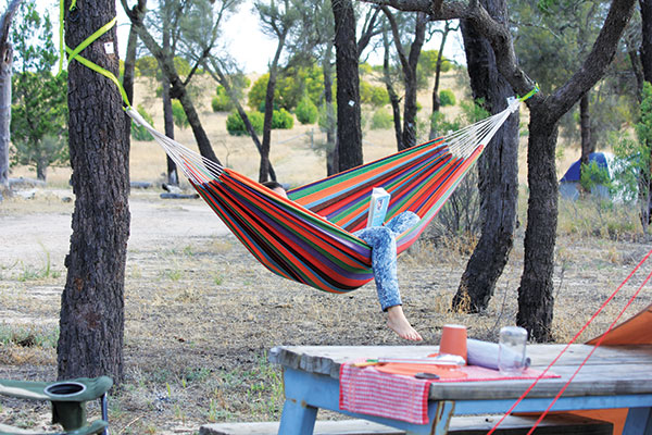 Relaxing -in -a -hammock -at -a -campsite