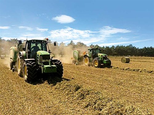 Baling -pea -vine -into -round -bales -82