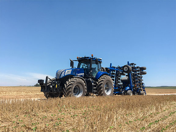 The New Holland T8 autonomous tractor working in a field