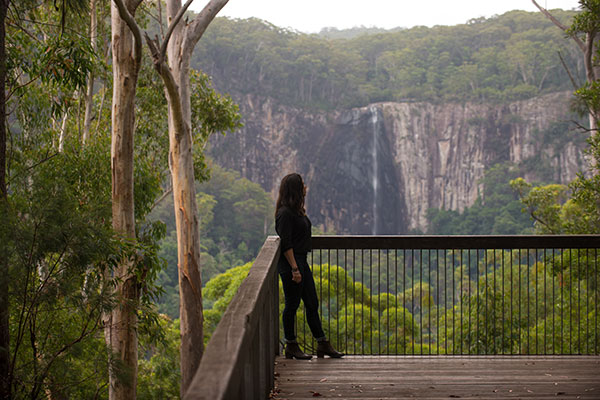 Woman -looking -at -Northern -Rivers -waterfalls -in -NSW