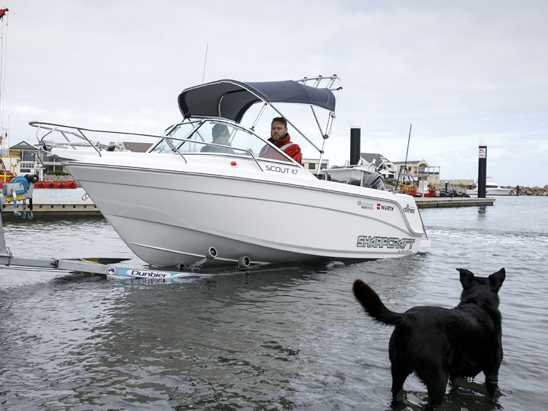 Trade -a -Boat Sharp Craft Scout 4.7 Test Launching Boat Dog