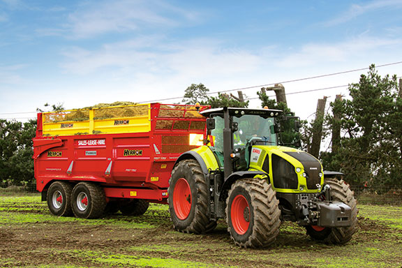 The Axion 930 pulls a Herron trailer