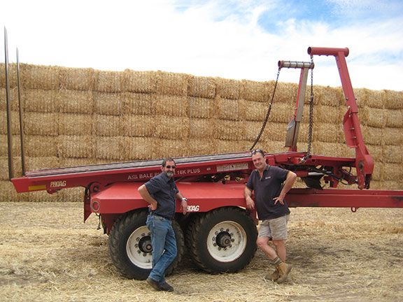 Geoff Perkins with SP Hay WA General Manager Rob Pauley and ProAG 16K plus