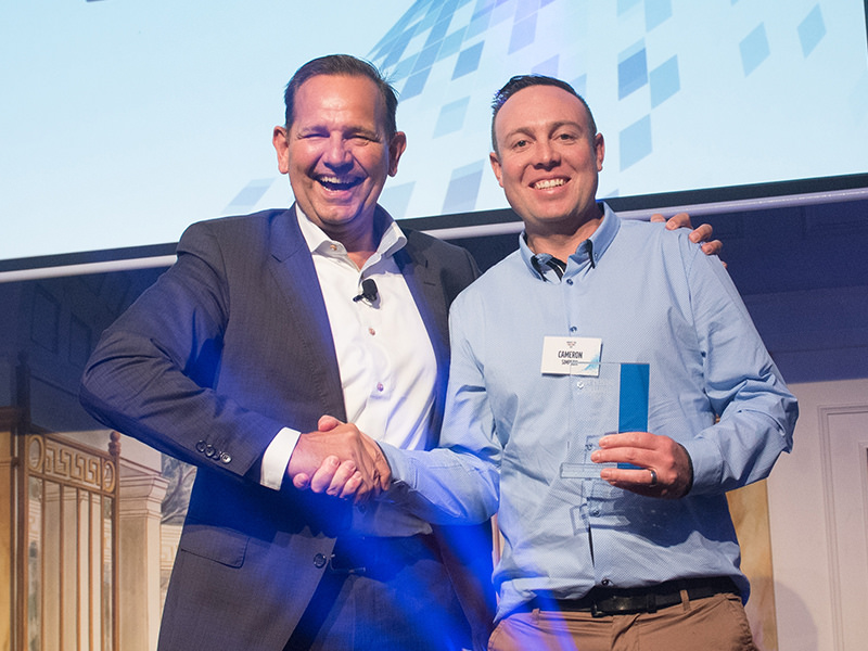 Winning grin: Volvo Group Australia (VGA) chief and strong advocate for drivers, Peter Voorhoeve (left) with off-road winner Cameron Simpson from Victoria