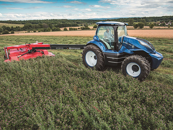 The New Holland Methane concept tractor pulling a mower