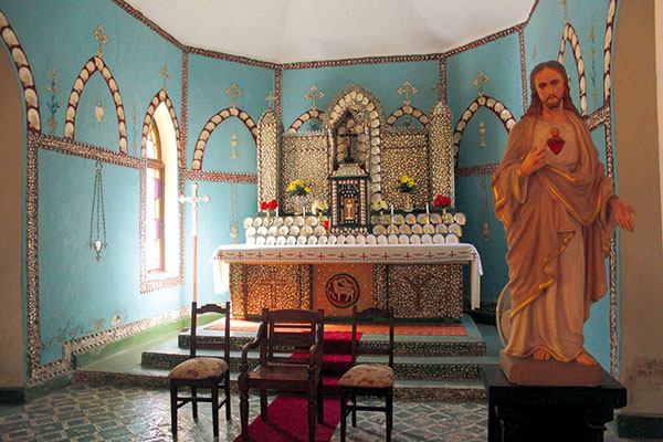 The -altar -at -Sacred -Heart -Church -is -ornately -decorated -with -pearl -shell -in -WA