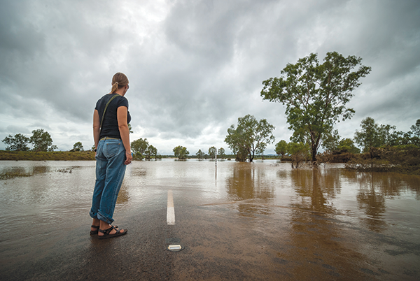 Woman -standing -on -a -flooded -road -in -outback -Australia