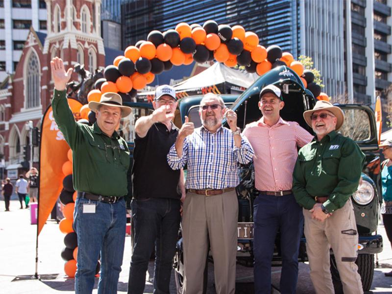 Peeter Liiv, Tony Clark, the lucky winner Trevor Fry, Paul Olds and Don Geer celebrate as the truck passes hands