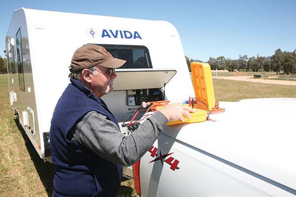 Man -fixing -the -Avida -caravan -electrics