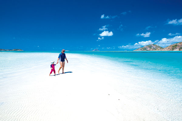 Woman -with -a -child -at -the -Resort -beach -in -Lizard -Island -Queensland -Australia